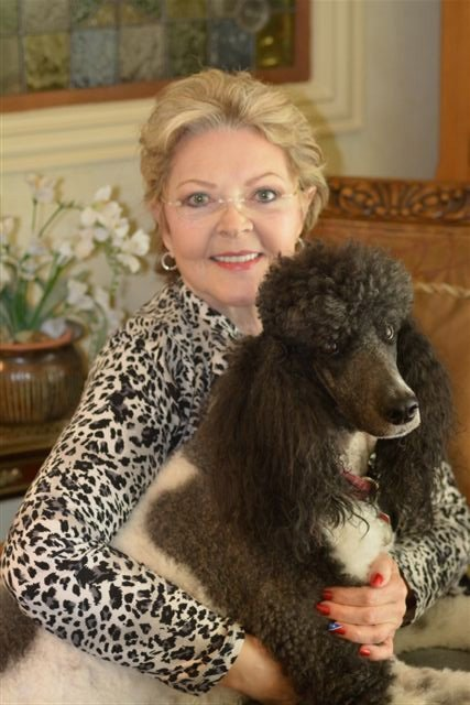 A Better Answer President and CEO Dee with her poodle Star