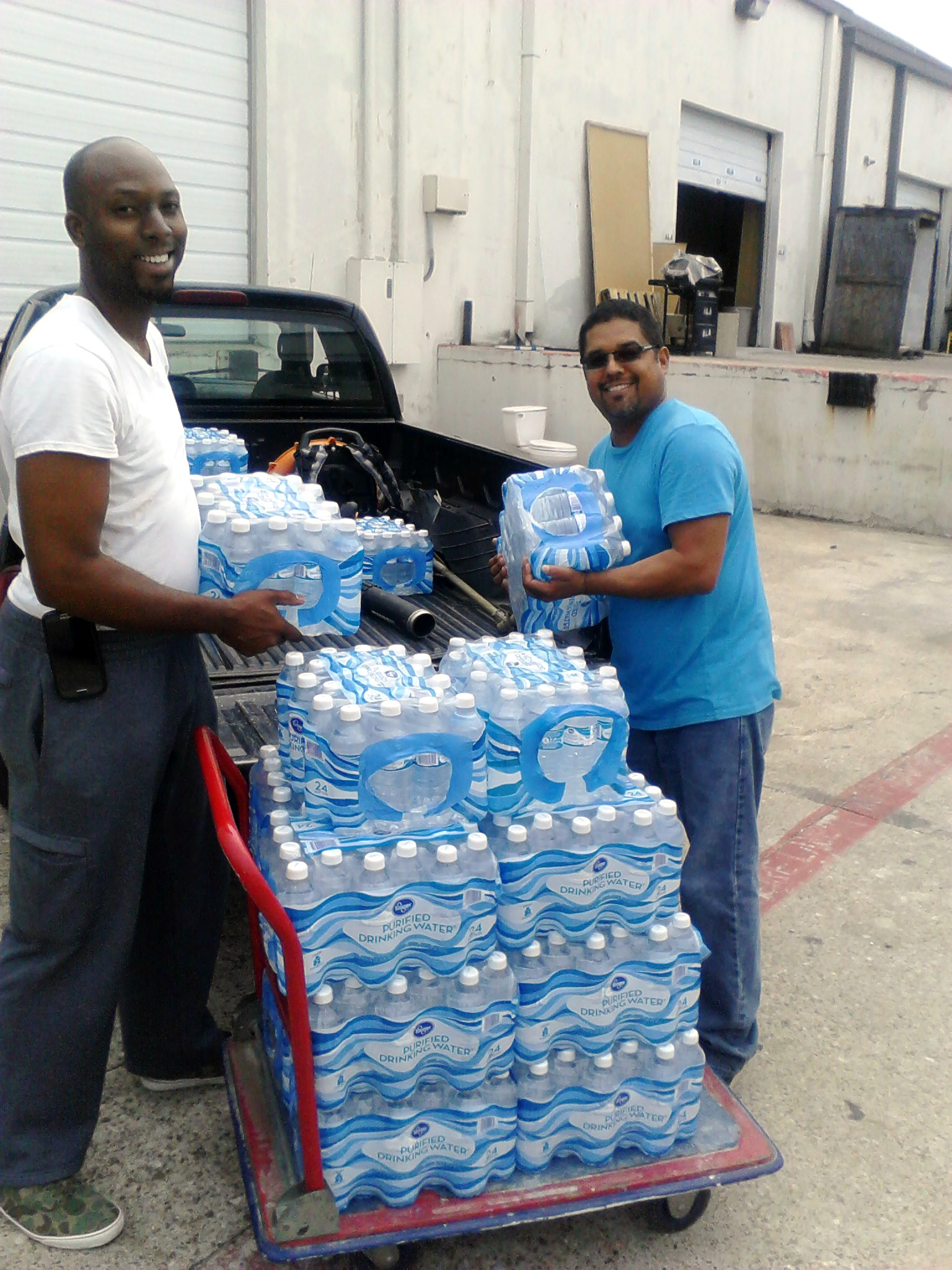 ABA Operators unloading a truck full of water for Habitat for Humanity